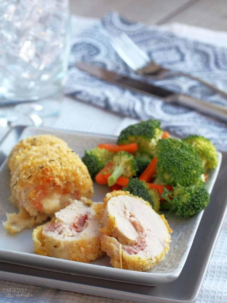 Chicken-Cordon-Bleu is a simple yet elegant weeknight dinner of tender breaded chicken rolled around ham and cheese.