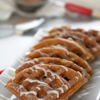 Pumpkin-Churro-Waffles, reminiscent of the popular street fair snack, are loaded with all the pumpkin and warm spiced flavors of fall with crisp, cinnamon sugared edges and an interior texture that practically melts in your mouth.
