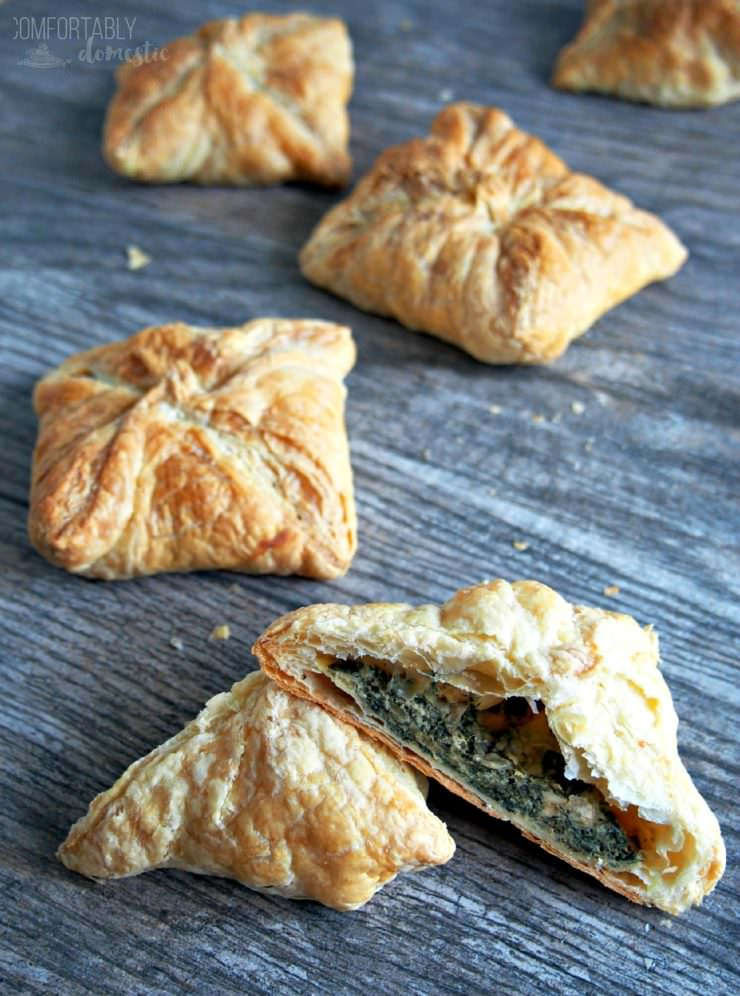 Spanakopita-Puffs-are-individual-spinach-pies-stuffed with a blend of tender spinach and plenty of herbed feta cheese, wrapped up in a buttery puff pastry shell.