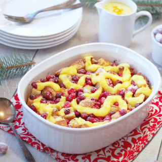 Cranberry-Orange-Bread Pudding is a simple, classic dessert all dressed up with fresh cranberries and a hint of orange for the holidays! Topped with a simple orange custard sauce, Cranberry Orange Bread Pudding is proof that leftover bread can easily be transformed into a delicious dessert.