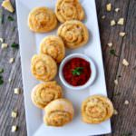 Cheesy-Italian-Herb-Pinwheels are buttery biscuits rolled with Italian seasoning and plenty of cheese for a savory three-bite appetizer that everyone will enjoy.