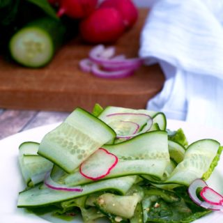 Cucumber-Ribbon-Salad tosses fun ribbons of ripe cucumber and other vegetables with a flavorful fresh pesto dressing in a cool and crunchy summer salad.
