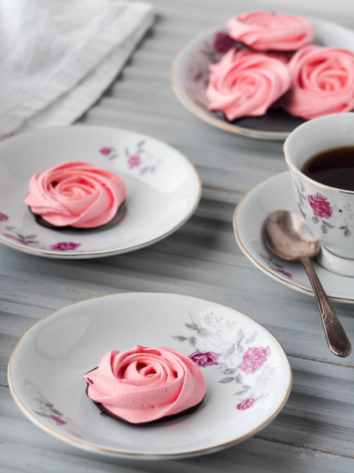 Rose-Meringue-Cookies are crisp, light, and airy cookies in the shape of sweet roses. A swirl through dark chocolate makes these low fat cookies a decadent treat!
