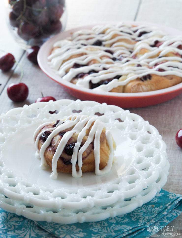 Cherry Sweet Rolls are sliced, soft sweet bread rolled into pinwheels with a tangy cherry filling and topped with a creamy icing.