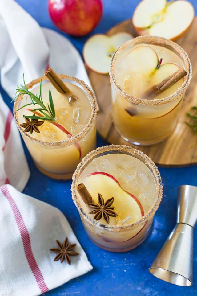 aerial-photo-of-apple-cider-margaritas-in-glasses-with-cinnamon-sticks-and-apple-slices