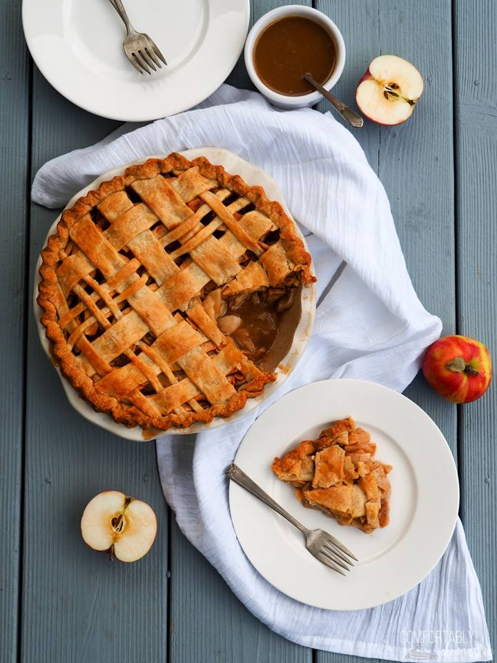 whole-caramel-apple-pie-with-lattice-crust-and-one-slice-on-a-white-plate-with-fork