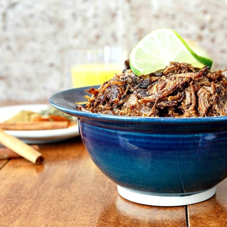 pile-of-smoky-beef-carnitas-meat-in-a-blue-bowl