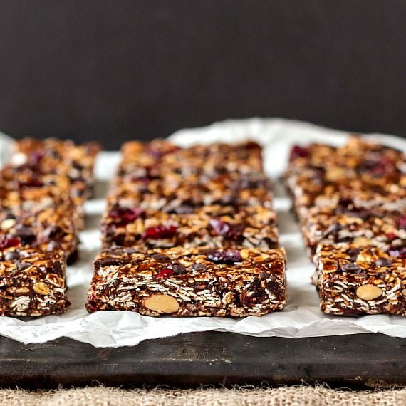no-bake-granola-bars-artfully-arranged-on-parchment-paper-and-a-cutting-board