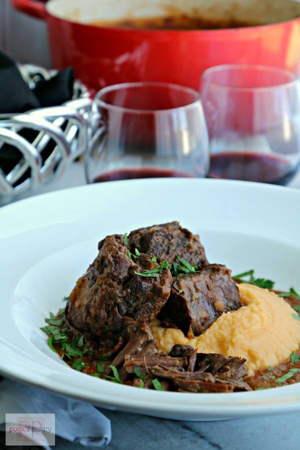 red wine glazed short ribs nestled in creamy rutabaga puree.