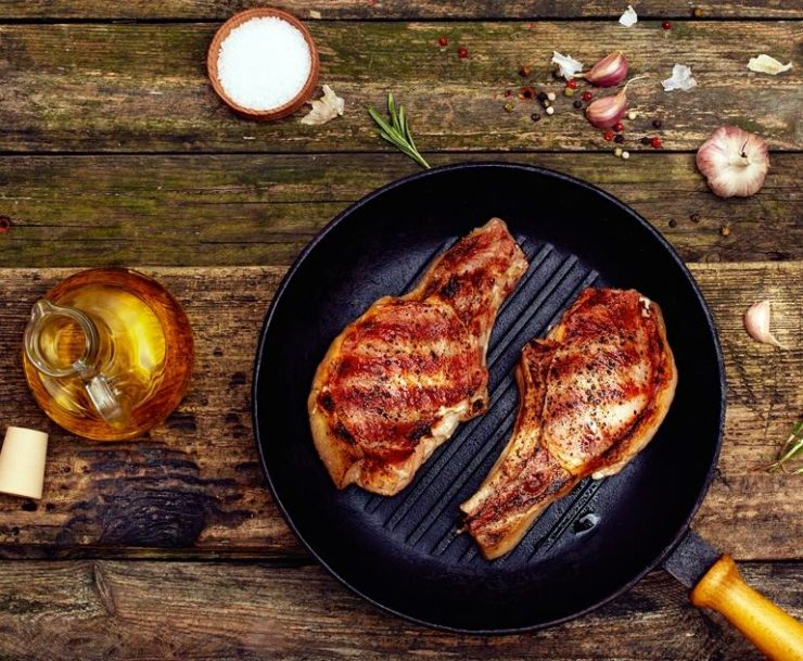 Pan-seared-pork-chops-in-a-cast-iron-skillet.
