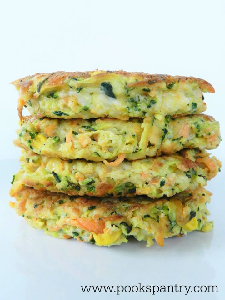 Stack of crisp veggie cakes on a white plate.