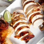 sliced-grilled-chicken-on a white platter