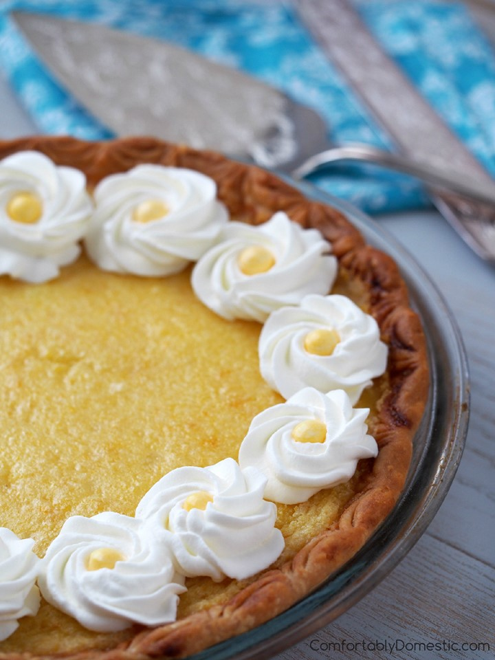 lemon chess pie with whipped cream swirls and yellow candy centers.