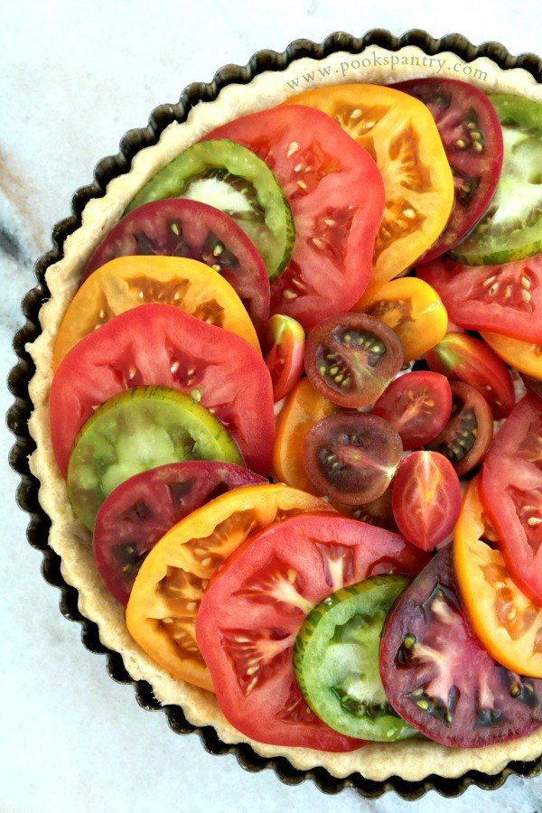 colorful sliced heirloom tomatoes in a pastry shell.
