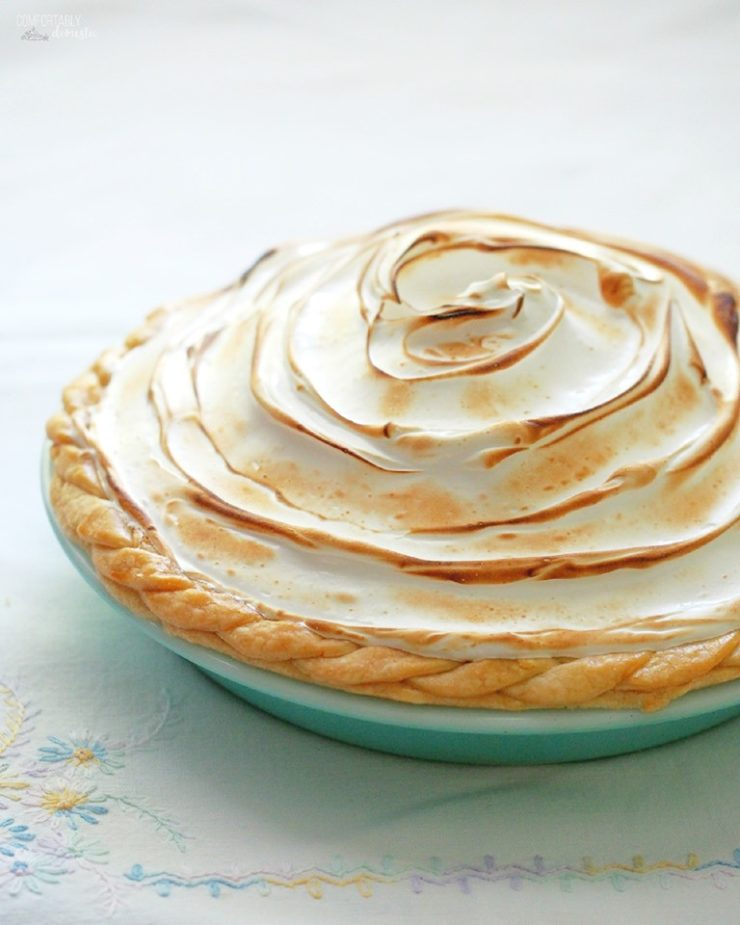 a whole lemon meringue pie with toasted meringue.
