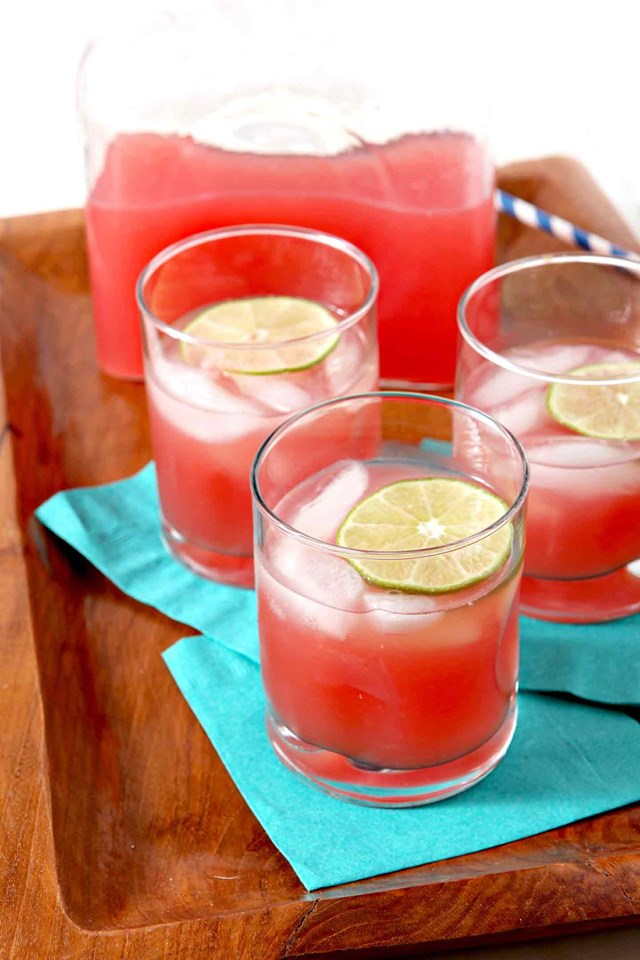 three glasses of watermelon limeade on green napkins.