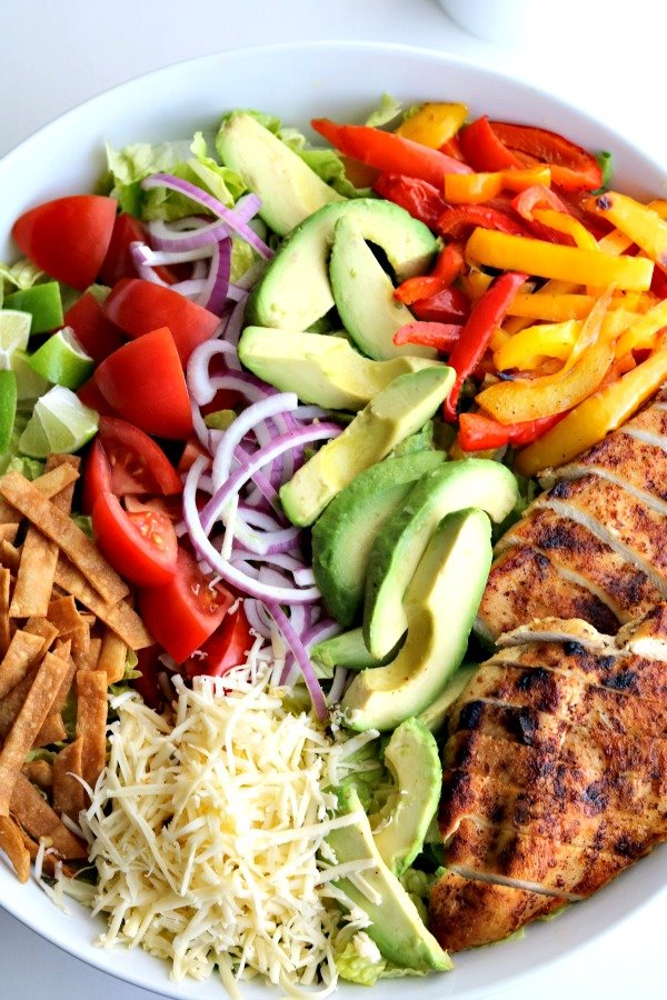 chicken-taco-salad with all ingredients grouped together charcuterie board style