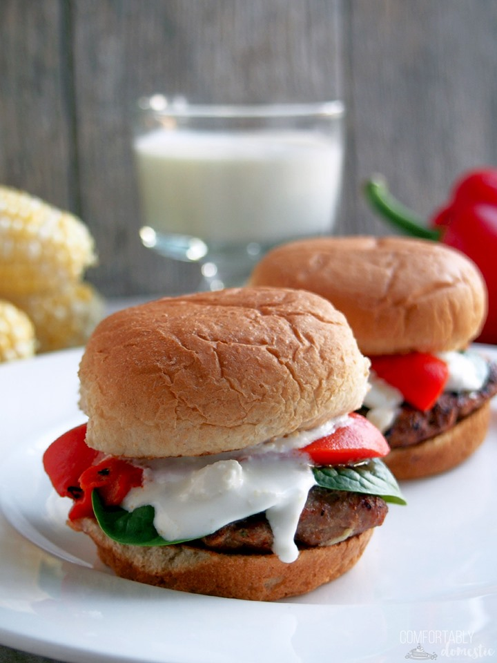 Two Greek turkey sliders on a white plate.