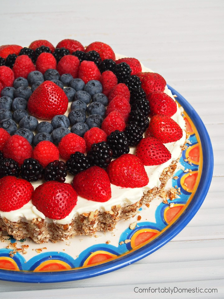Lemon Mousse Tart with fresh berries arranged on top.