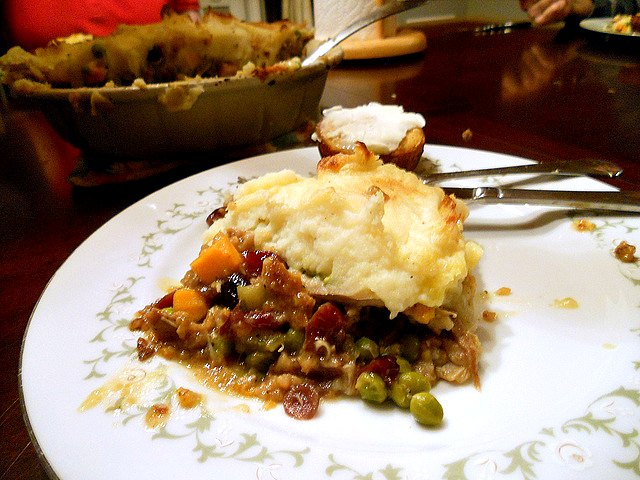 Thanksgiving leftovers shepherd's pie on a white plate.