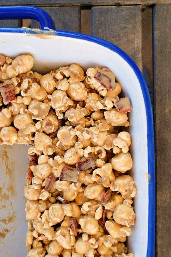 Maple bacon popcorn treats in a large white baking dish.