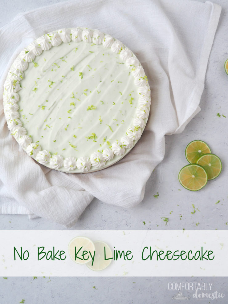 No Bake Key Lime Cheesecake on white background with fresh lime slices.